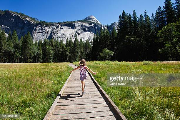 Girl walking on a footpath in Yosemite Valley