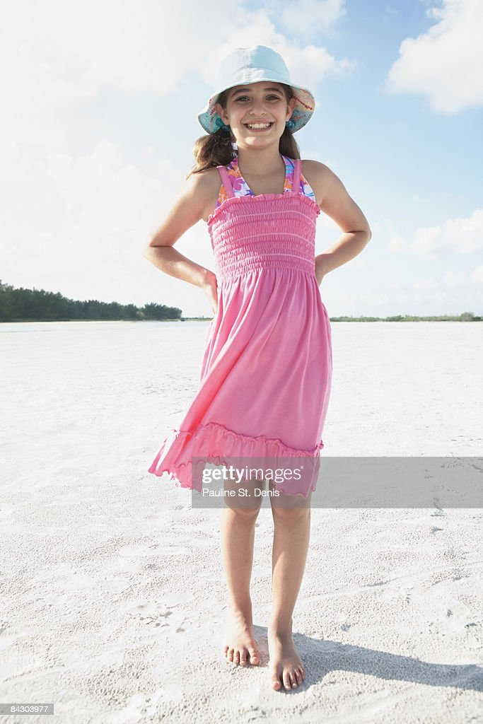 Girl Walking On Beach High-Res Stock Photo - Getty Images