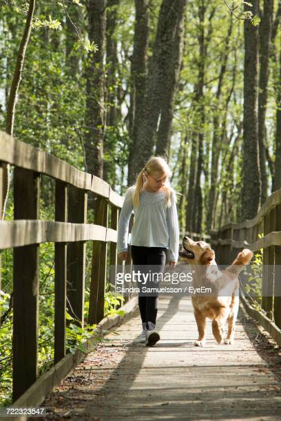 Girl Walking On Footbridge