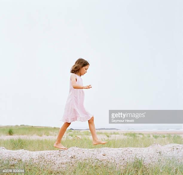 Girl Walking on Log