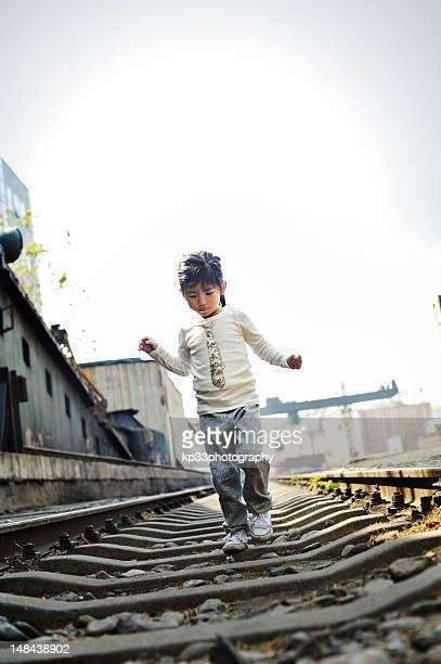 Girl walking on rail