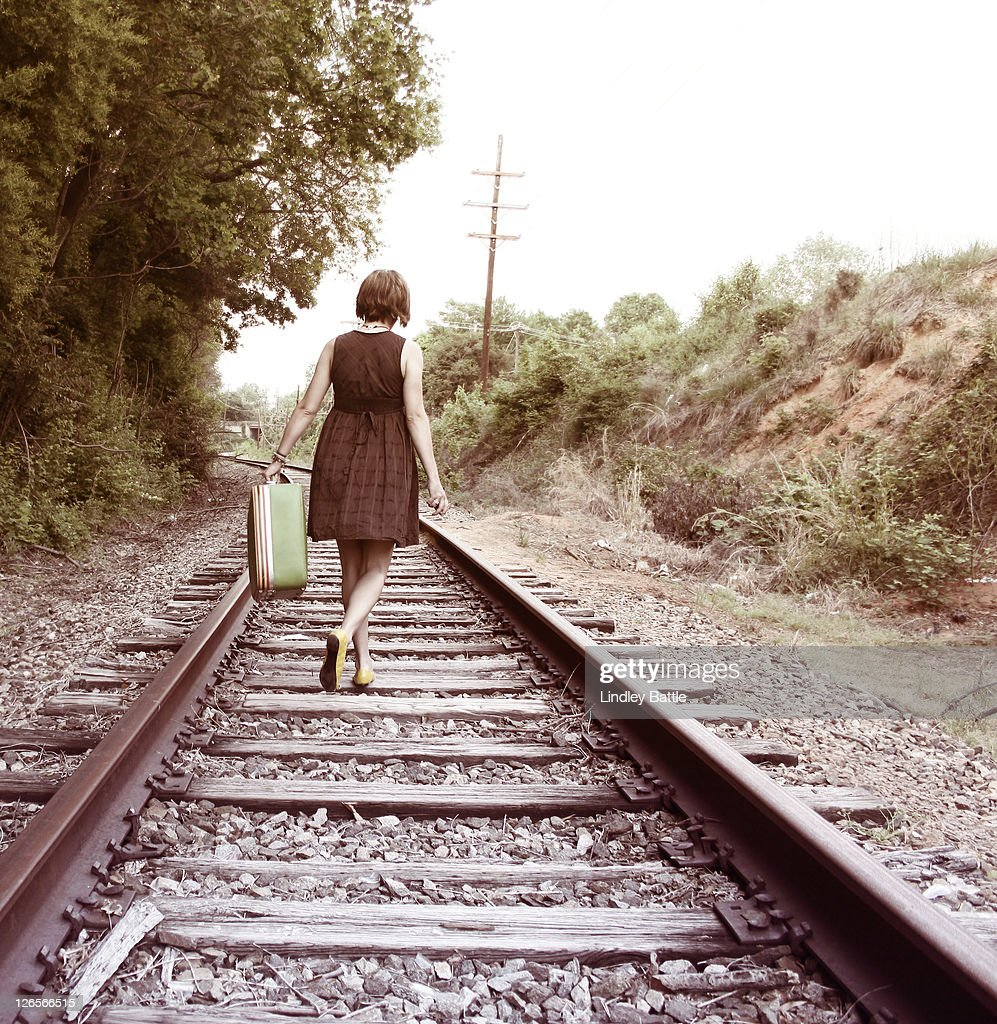 Man Walking On Railroad Tracks Stock Photo - Image of