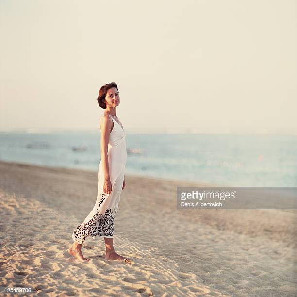 Girl walking on sand beach
