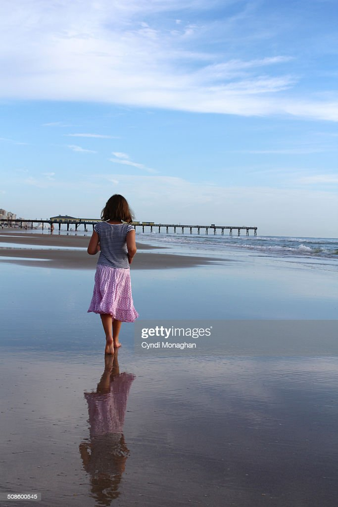 Girl Walking on Sand : Foto de stock
