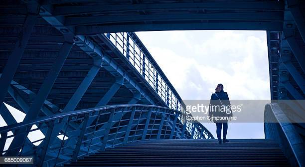 Girl walking on staircase