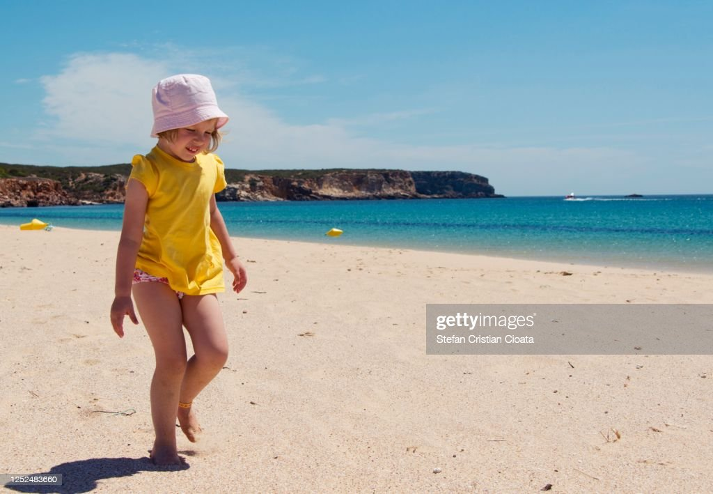 Girl walking on the beach at summer in Sagres, Portugal : ストックフォト