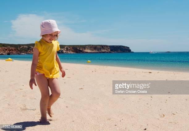girl walking on the beach at summer in sagres, portugal - sagres bildbanksfoton och bilder