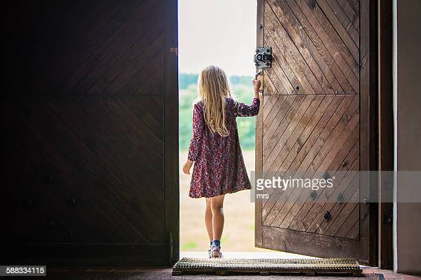 Girl walking out the door