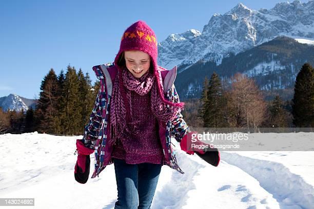 A girl walking through a snowy landscape