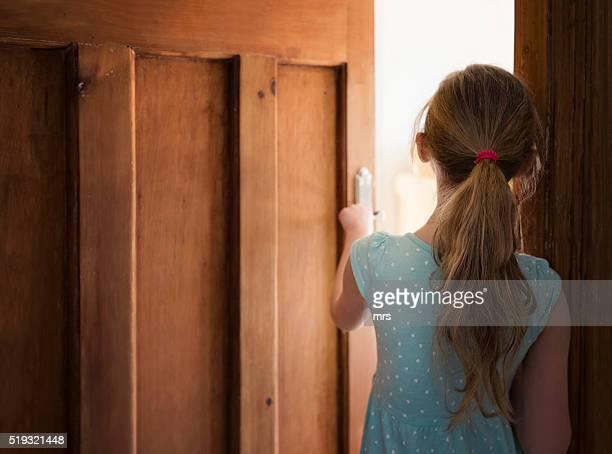 girl walking through door - ajar stock pictures, royalty-free photos & images