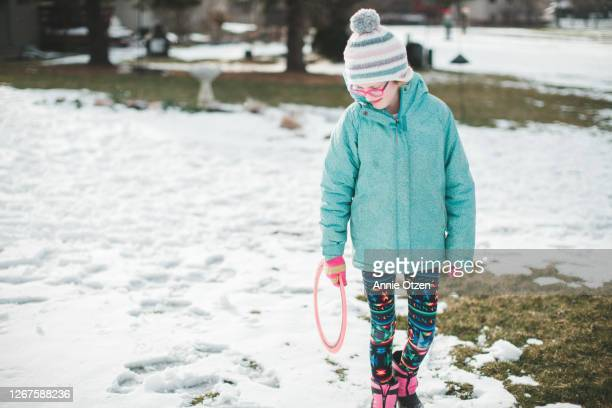 girl walking through the snow - sioux falls stock pictures, royalty-free photos & images