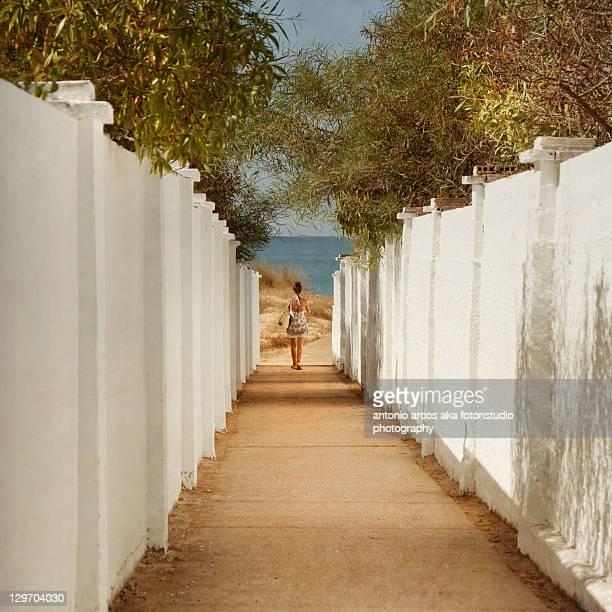 Girl walking towards beach