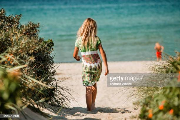 girl walking towards the beach and sea - funen stock pictures, royalty-free photos & images