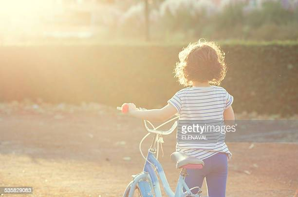 Girl walking with her bicycle