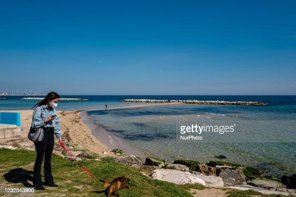 Girl walking with her dog on the first day in the orange zone after more than a month in Bari on April 26, 2021. Italy tries to restart and Puglia...