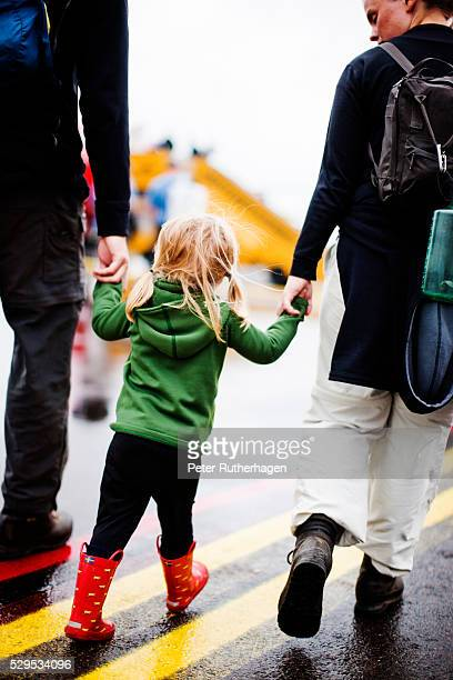 girl walking with parents - norrbotten province stock photos and pictures