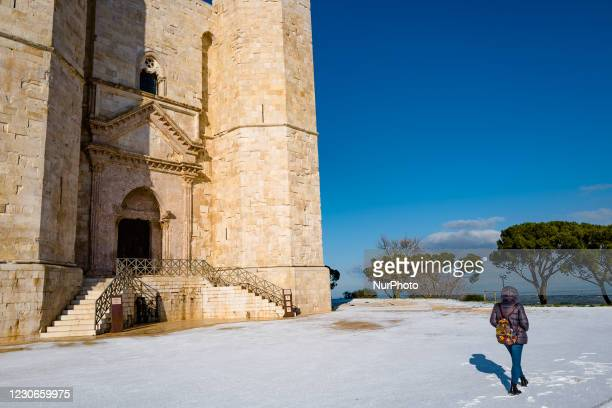Girl walks around the Castel del Monte snow-capped by the snowfall of the night on January 18, 2021. The cold wave continues in Puglia, another night...