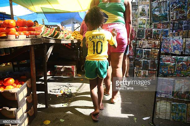 A girl walks in a Brazilian soccer jersey in the occupied Complexo da Mare one of the city's largest 'favela' complexes on June 7 2014 in Rio de...