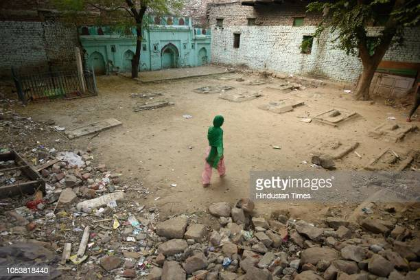 A girl walks inside the compound of a mosque after an eightyearold student of a Madrasa died after he sustained a head injury during a scuffle...