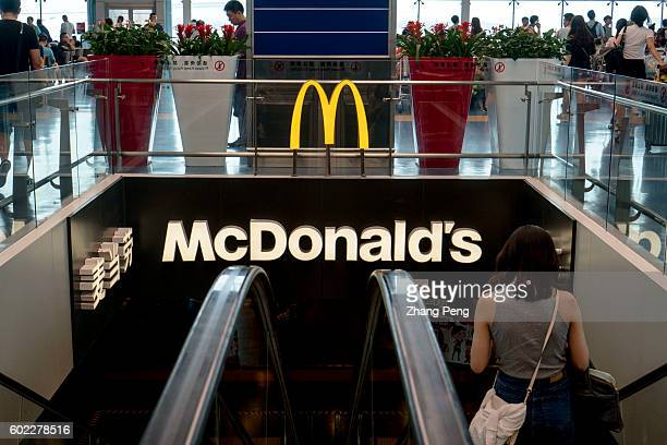 A girl walks into a McDonald's restaurant in airport terminal While Yum brands entered into a deal with Chinese local investors facing a declining...