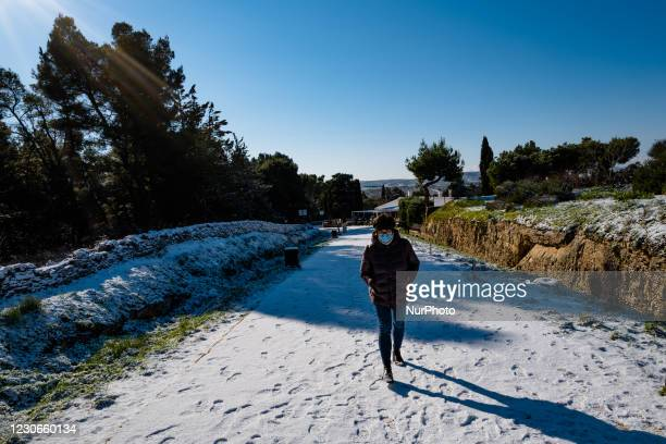 Girl walks on the road to the snow-covered Castel del Monte on January 18, 2021. The cold wave continues in Puglia, another night below zero in part...