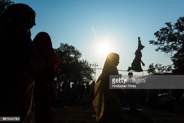 A girl walks on the tight rope as she entertains people with her skills at Sonepur Mela at Konhara Ghat on November 4 2017 in Bihar India The Sonepur...