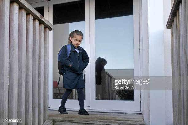girl walks out of her home to school - rafael ben ari stock pictures, royalty-free photos & images