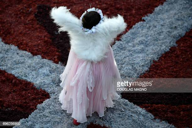 Girl walks over a sawdust carpet during the Catholic Corpus Christi celebration in a street of Ouro Preto, some 100 km from Belo Horizonte, Brazil,...