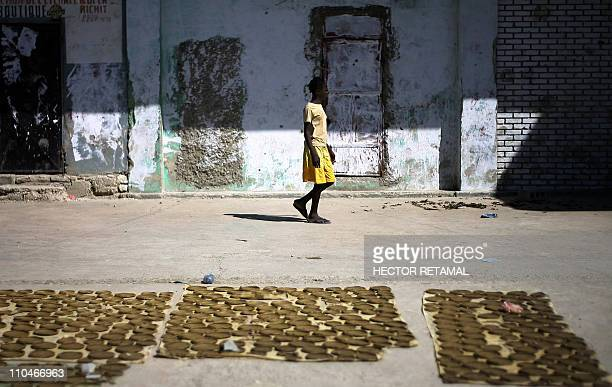 GUIHAIREA girl walks pass by mud cakes in Fort Dimanche in PortauPrince Haiti January 22 2011 A prisoner's worst fate was to be dragged off to Fort...