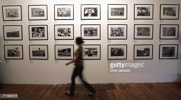 A girl walks past photographs at the 'Shoot' World Cup photo exhibition at the Proud Camden gallery on June 6 2006 in London England Subtitled The...