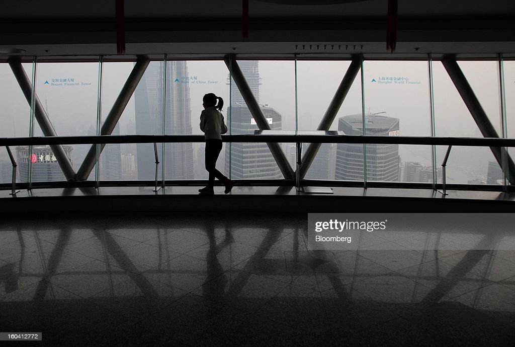 A girl walks through the observation deck on the Oriental Pearl Tower in the Pudong area of Shanghai, China, on Wednesday, Jan. 30, 2013. China's economic growth accelerated for the first time in two years as government efforts to revive demand drove a rebound in industrial output, retail sales and the housing market. Photographer: Tomohiro Ohsumi/Bloomberg via Getty Images