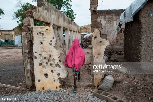 TOPSHOT A girl walks through the site where the Nigerian Air Force mistakenly bombed the Rann InternallyDisplaced Peoples camp in northeastern...