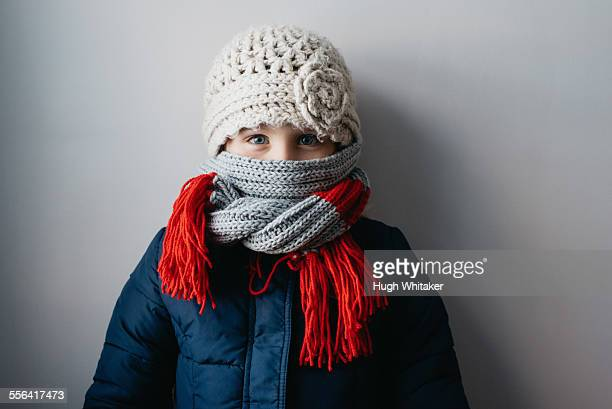 girl warmly wrapped up in woollen hat and scarf - schal stock-fotos und bilder