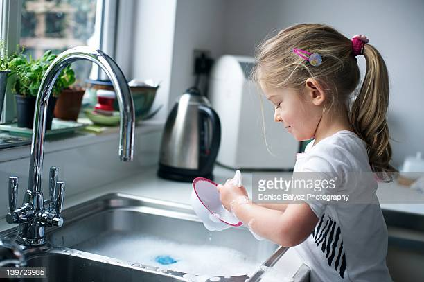 Girl washing dish