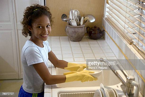 girl washing dishes - kids with cleaning rubber gloves stock pictures, royalty-free photos & images