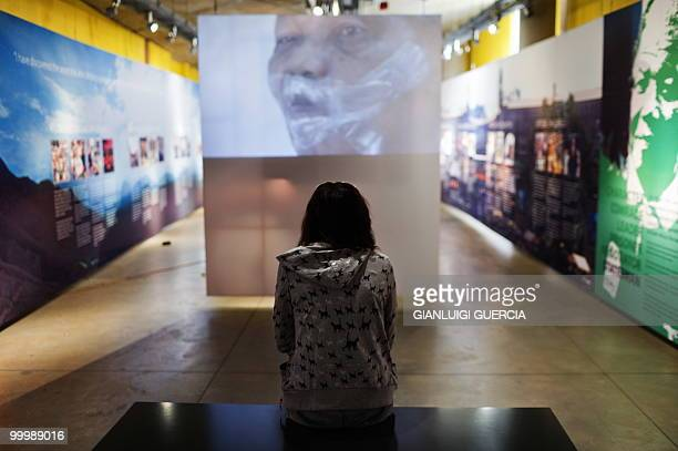 A girl watches a documentary on Former South African president and Nobel peace prize laureate Nelson Mandela on May 19 2010 at the Apartheid museum...
