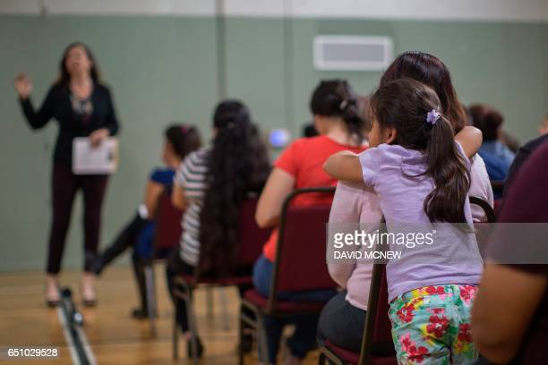 A girl watches during a workshop for immigrants to make a preparedness plan in case they are confronted by immigration officials at Academia Avance...