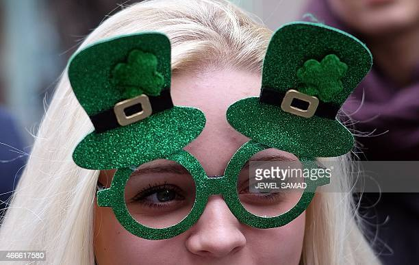 A girl watches marchers during the St Patrick's Day parade in New York on March 17 2015 AFP PHOTO/JEWEL SAMAD