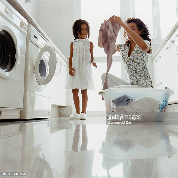 Girl Watches Mum Doing Laundry