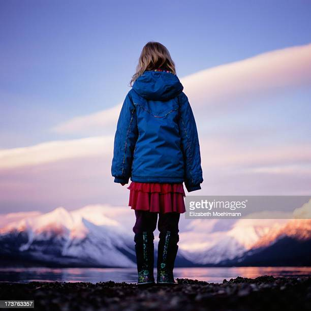 girl watches sunset at glacier national park - jacket stock pictures, royalty-free photos & images