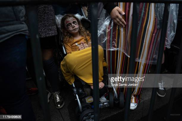 A girl watches the Day of the Dead parade on Paseo de la Reforma Avenue on November 2 2019 in Mexico City Mexico Observants celebrate the Day of the...