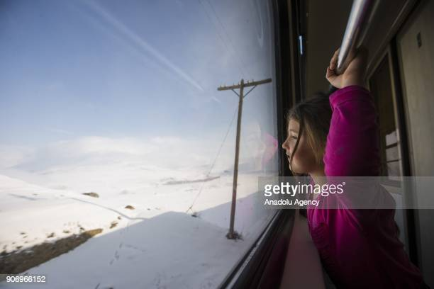 A girl watches the landscape as she travels with the Eastern Express which travels from Ankara to Kars in Kars Turkey on January 13 2018 With the...