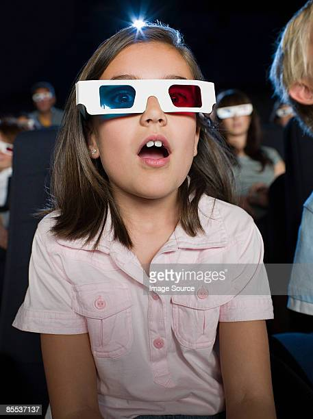 A girl watching a 3d movie