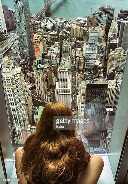 A girl watching New York skyline.