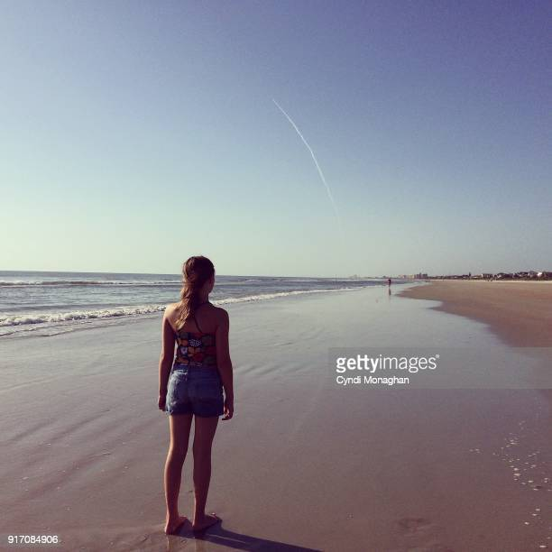 girl watching rocket launch into space - launch event stock pictures, royalty-free photos & images