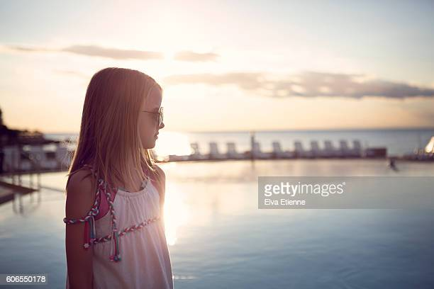 girl (9-10) watching sunset over water - adriatic sea stock pictures, royalty-free photos & images