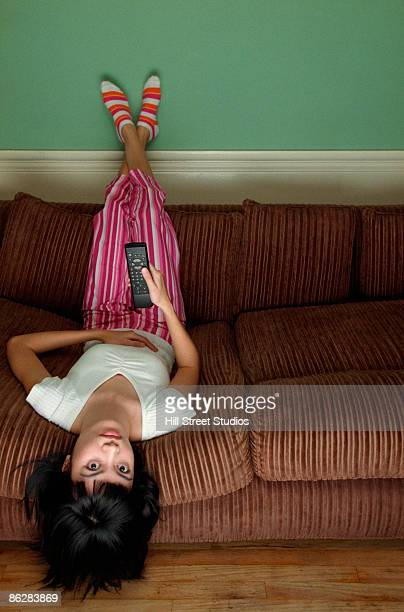 Girl watching television upside down