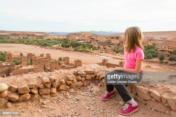 girl watching the ksar of ait ben haddou, morocco, africa - moroccan girls stock photos and pictures