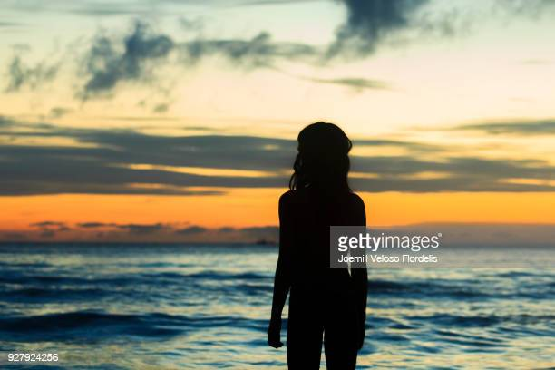 A girl watching the sunset by the beach (Boracay Island, Malay, Aklan, Philippines)