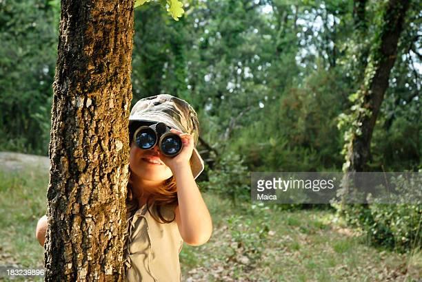 Girl watching through binoculars